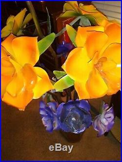 Metal yard art flowers in Metal Pot